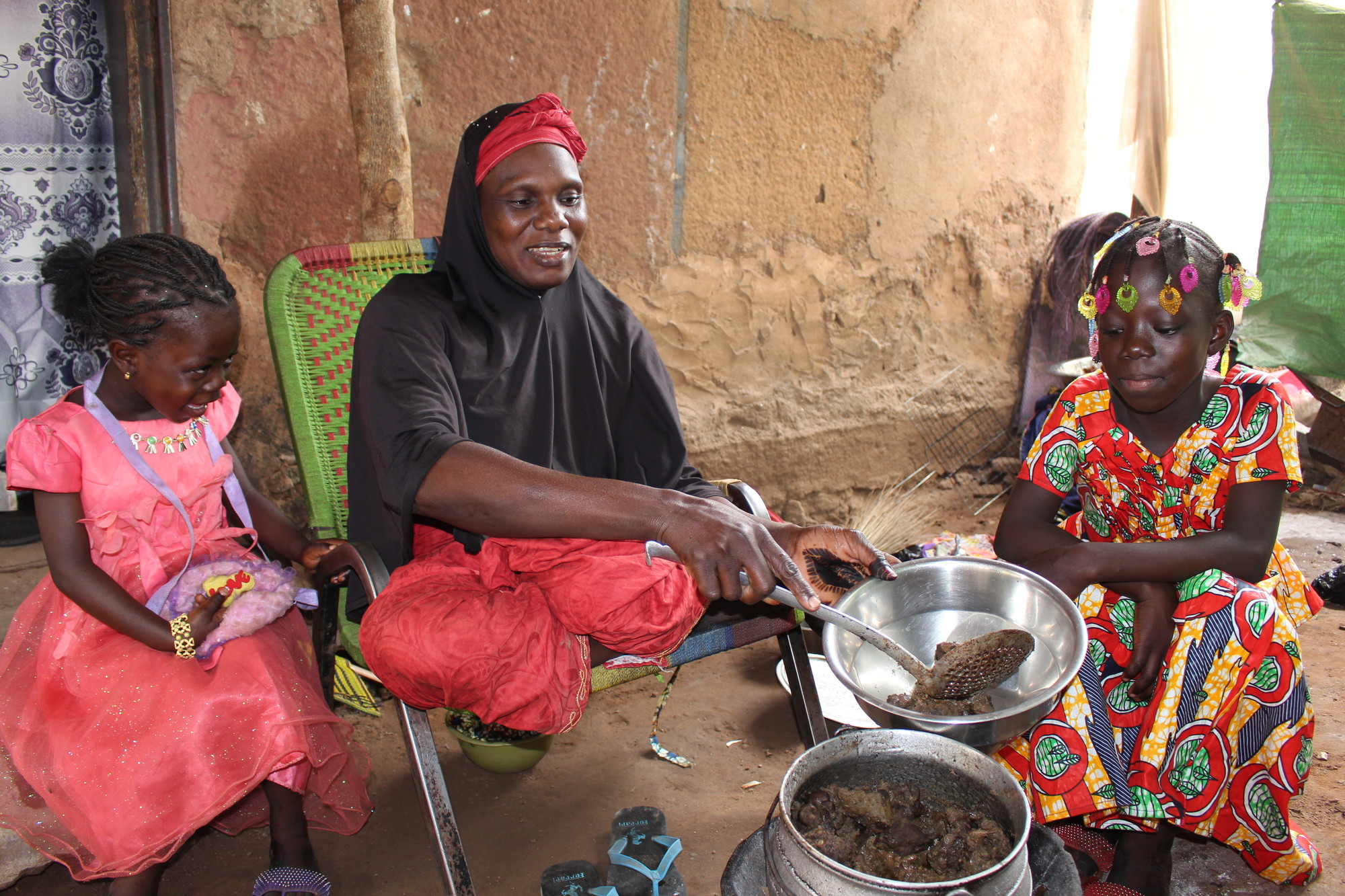 Aminata cooks some of the 4kg of qurbani beef that they received last year.